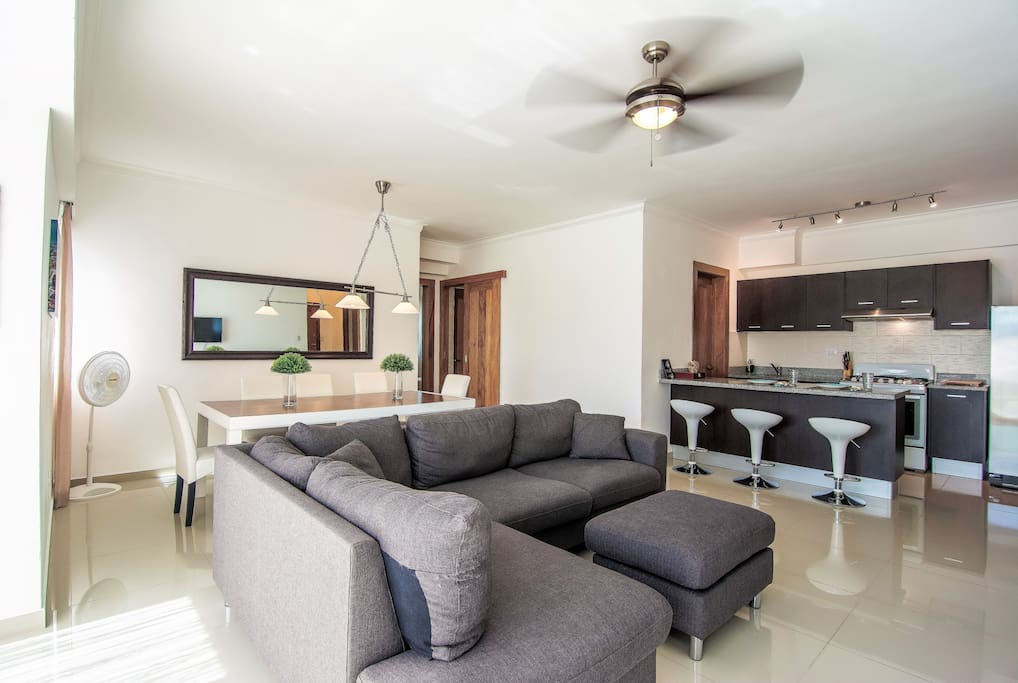 The Spacious Livingroom comes with a Fully Equipped Open Kitchen with breakfast Bar, Spacious Balcony with Beautiful City Views, Smart TV with Cable, Fast WIFI, Dining Area and Lounge Area