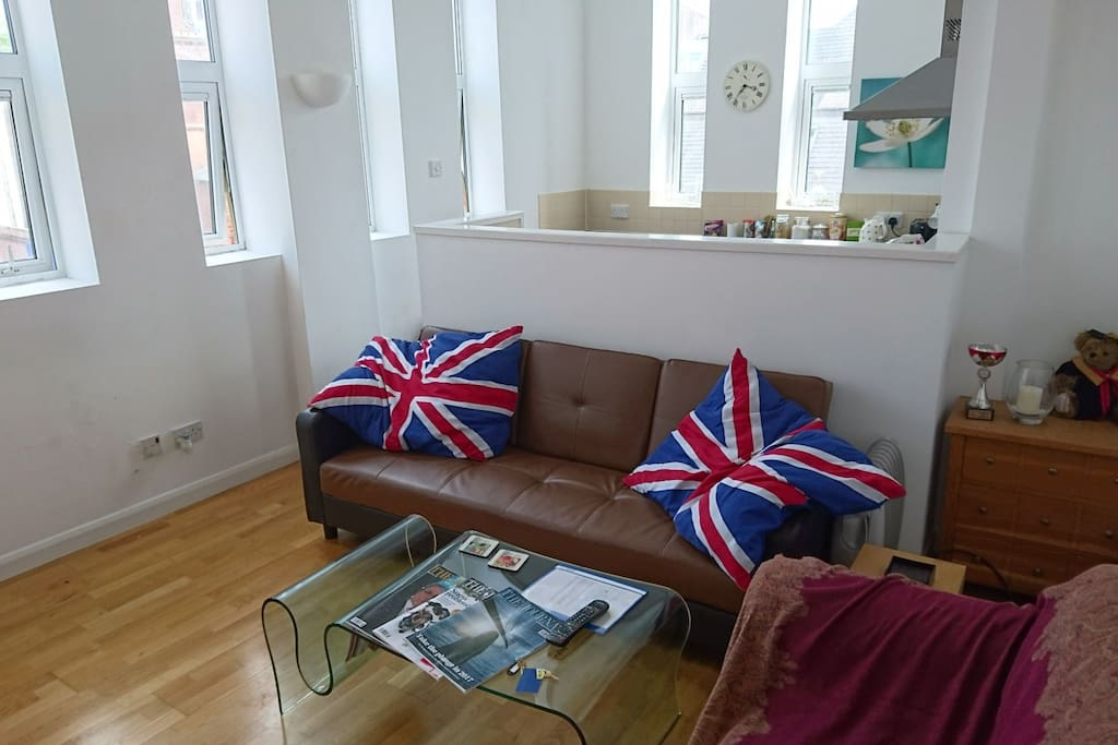 Sofa bed is the one with flag themed cushions