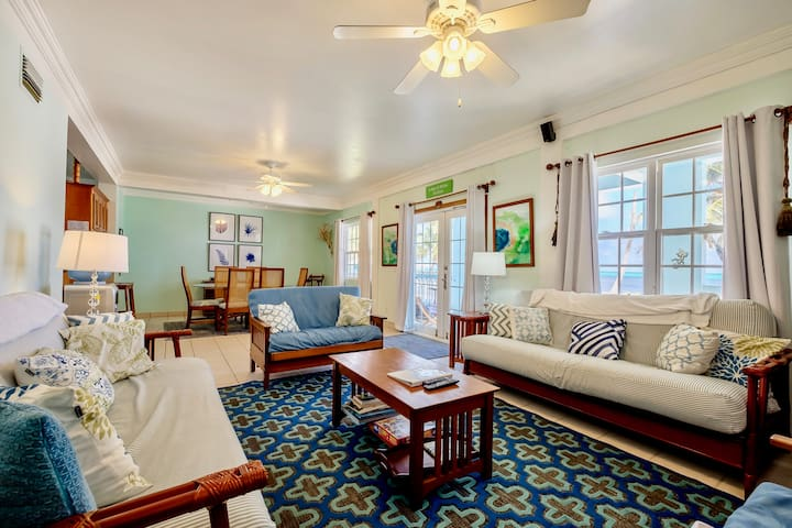 Living room with two queen futons; double doors to porch to right
