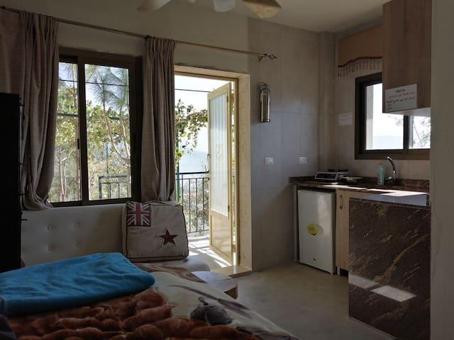 Rustic mountain escape with a view, Garden Room