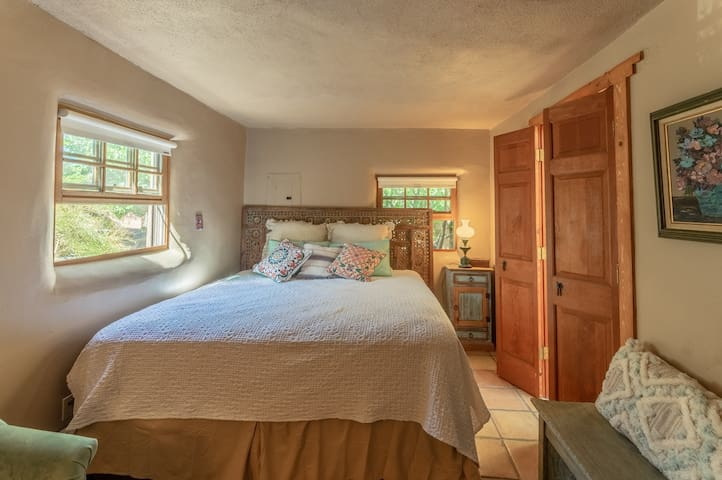 Cozy master bedroom with king bed and ensuite bathroom and shower.