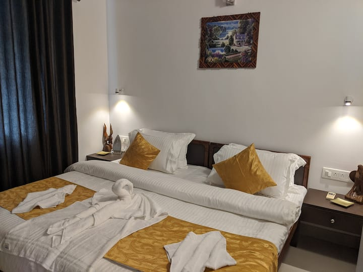 Full AC Bedroom at Downtown Candolim - Silvi Stays