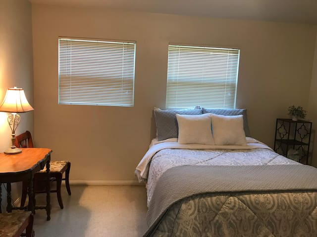 Comfortable queen size bed with desk available
