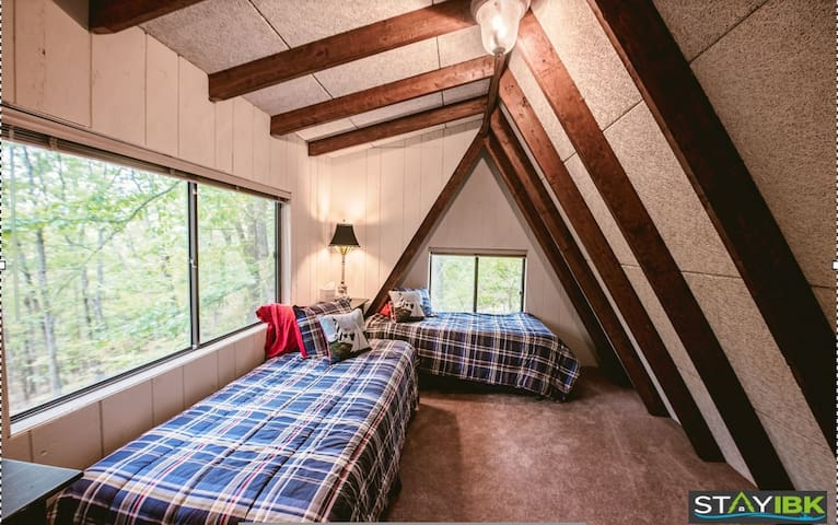 Bedroom 3.  Two twin beds.  Lots of windows for a great view