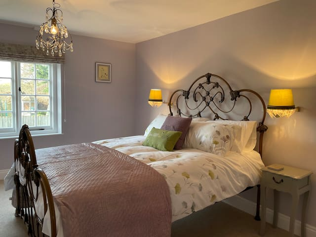 The beautiful bedroom with king size bed and double wardrobe