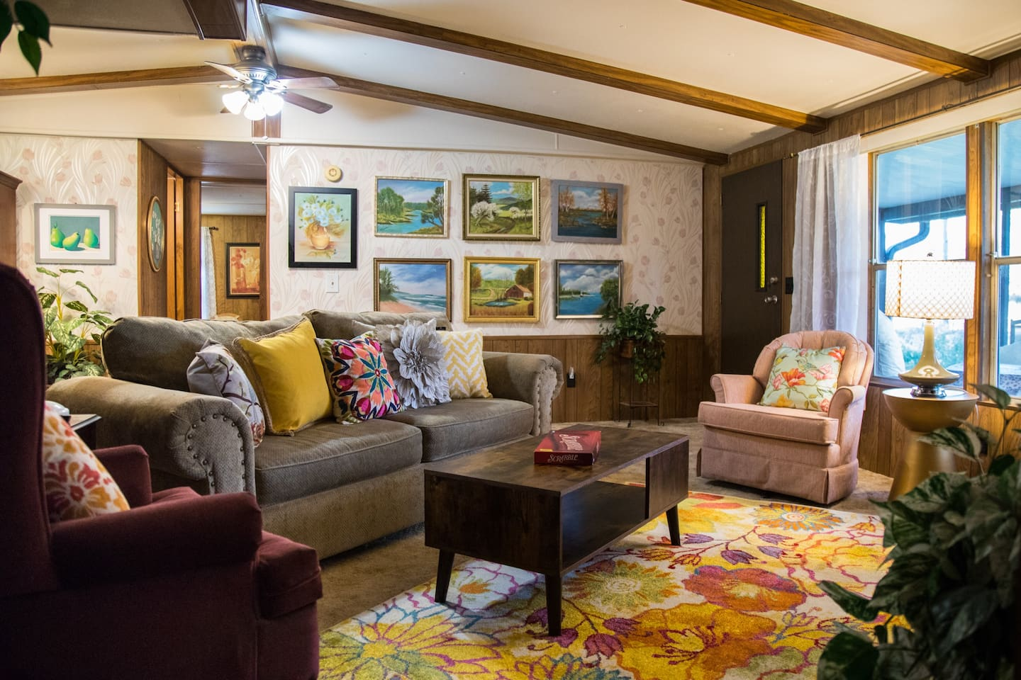 Step into cozy & feel right at home with friends and family, just as if you were at grandma's house. You'll  enjoy Mama Margie's original artwork on the wall behind the sofa. Far enough from the hustle and bustle, but close enough when you want it.
