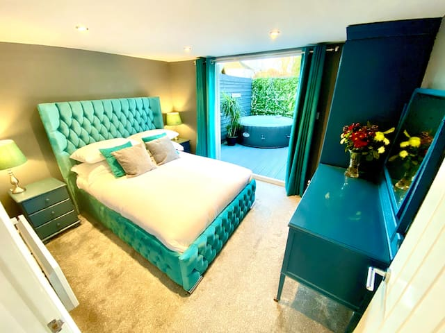 Bedroom leading out to private hot tub.