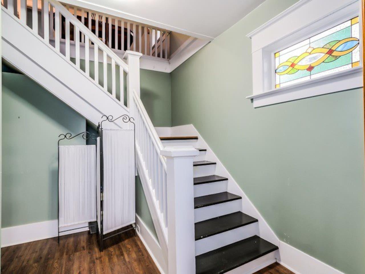 Stairway leading to second floor two-bedroom suite