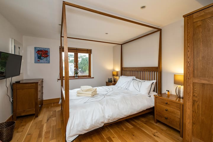 Four-poster room, with king-size bed, TV, dual aspect and en-suite