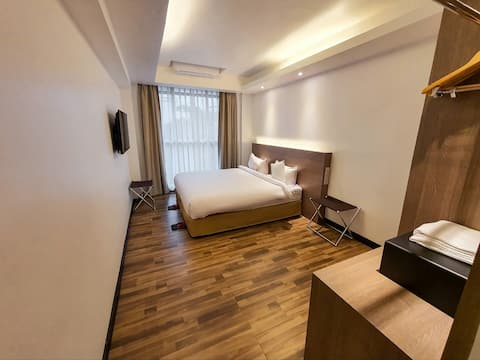 Extended-stay Hotel with Shared Kitchen & Laundry