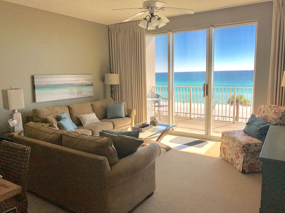Living room has queen sleeper sofa with access to balcony and full views of the Gulf