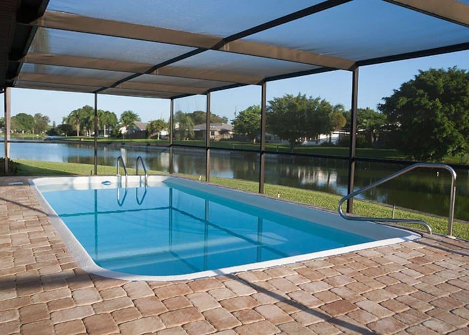 Screened pool overlooking the lake.