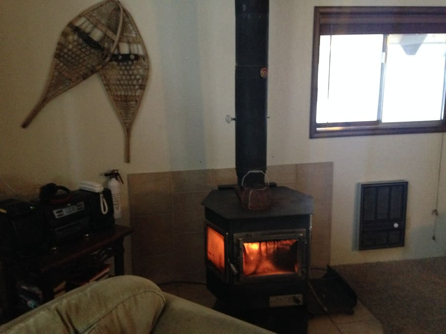 A cozy woodstove keeps the cabin nice and hot