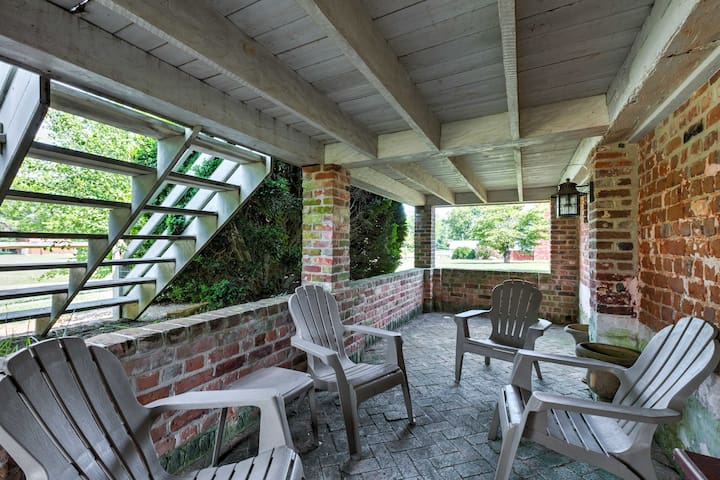 Below the front porch, guests will find an outdoor living area.