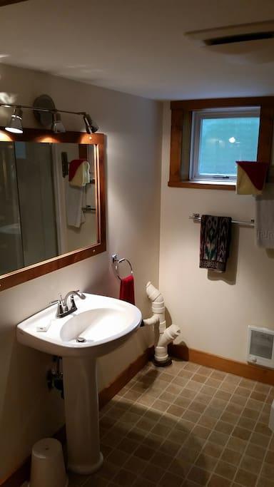 Nice bathroom with built in fan and big bathroom window for fresh air