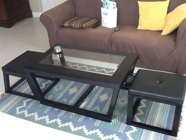 Living room table with pull out seat for extra seating