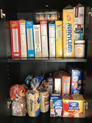 Breakfast cabinet for guests that includes hot and cold cereals, bagels, breads and more. Please note breakfast assortment and fruit may vary and are available for breakfast only.