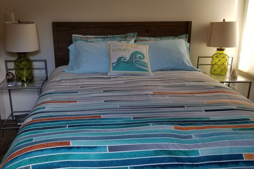 Queen bed with Sealy pillow top mattress.
