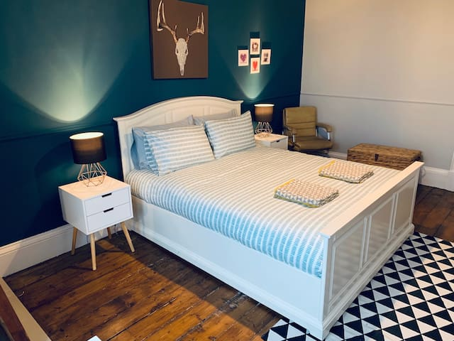 Comfy king-size master bedroom.