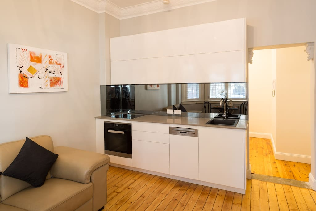 Modern kitchen with Miele oven / cooktop and dishwasher