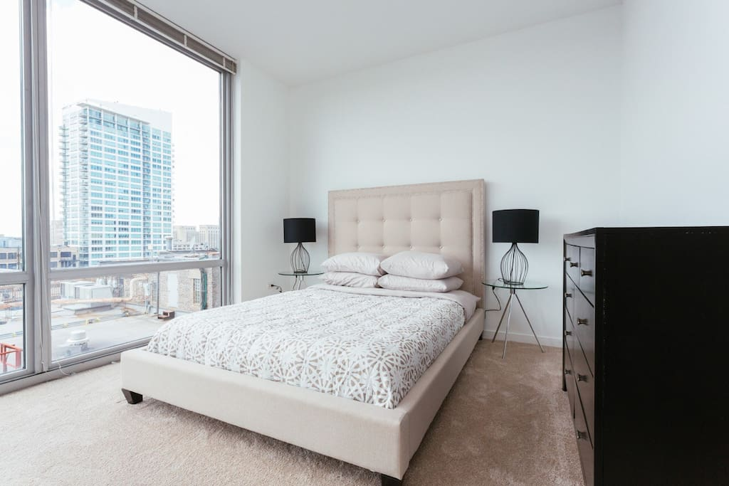 Master Bedroom with Private Bathroom and Walk-in Closet and access to the balcony.