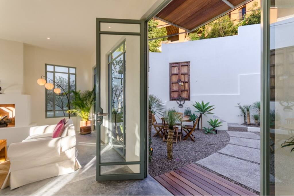 Glass Doors surround the lower level of the house for a very tranquil Indoor/Outdoor living experience