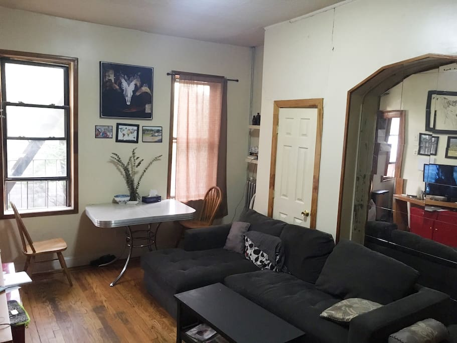 Shared living room, with large comfy couch, TV with Netflix, Hulu, and Antenna channels. There is also an easy plug in to a speaker system, so you can easily plug into and phone/tablet/ computer to enjoy your tunes.  Space also includes kitchen table area, just outside of kitchen.  Entire apartment has free Wifi access as well