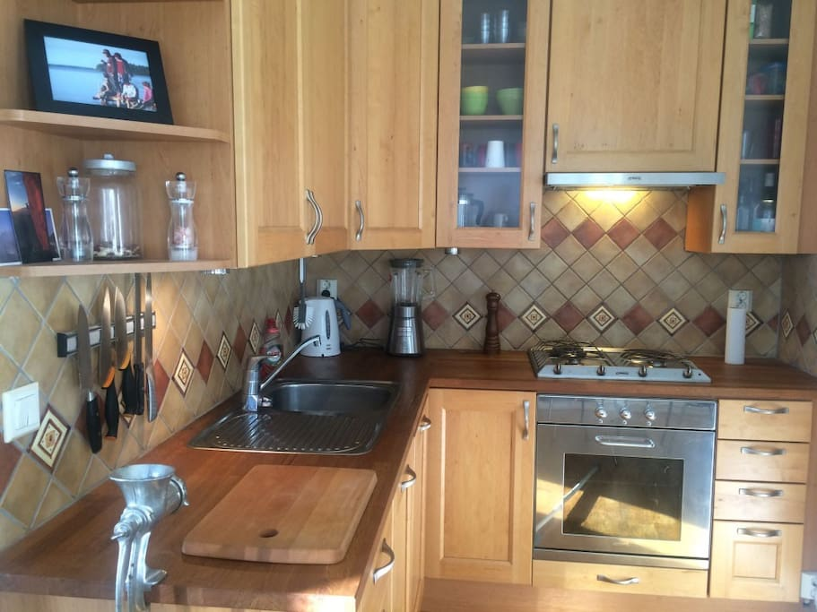 The delightful kitchen is equipped with a Smeg gas stove and the highest quality kitchenware.