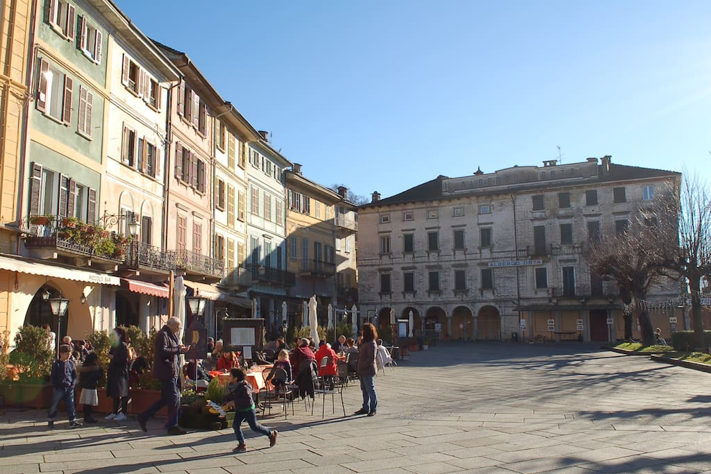 The apartment is right in the main square of Orta (last orange house in the corner)