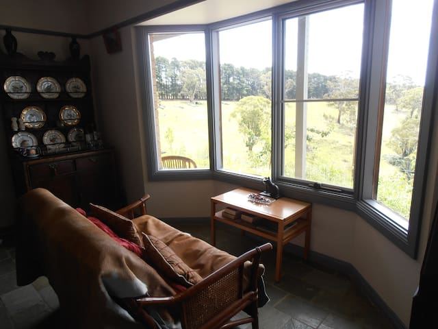 The guest lounge is very comfortable and positioned to take full advantage of the view across the paddocks and mountains. Perfect to sit and relax while enjoying a wine