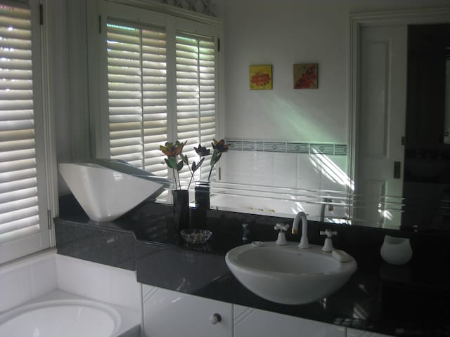 Spacious bathroom area.