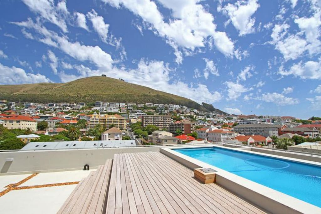 Swimming pool with tanning chairs - stunning views of Signal Hill