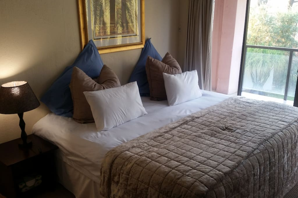 Comfortable king-sized bed with luxury micro-fibre duvet and Egyptian cotton duvet cover.