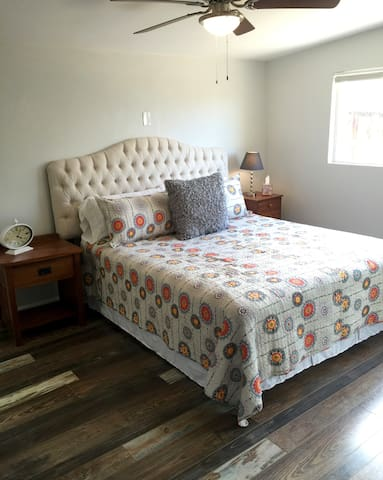 Master bedroom has a large Cal King bed with access to ensuite bathroom and large closet.