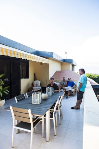 A Hammock, Patio Table seating 6 , plus lounge furniture await your respite moments after your busy days in Port au Prince.