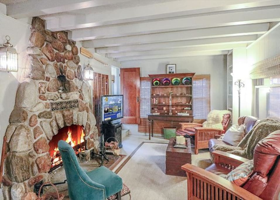 Cozy living room that is perfect for family time and snuggling up by the fireplace.