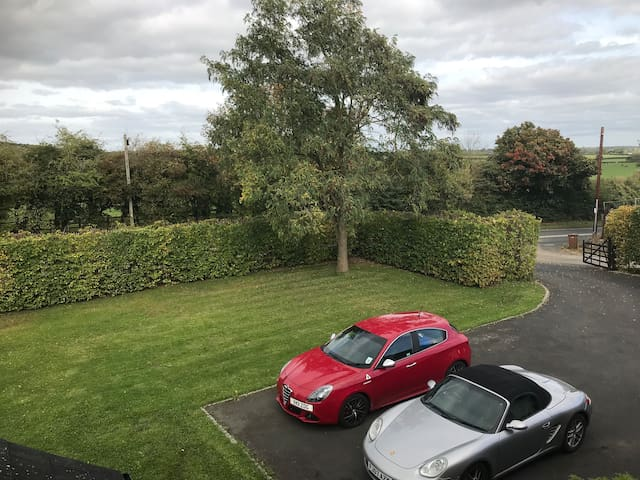 Front garden seen from bedroom. Lots of room for children to play. Gate can be closed. Parking for 10+ cars.