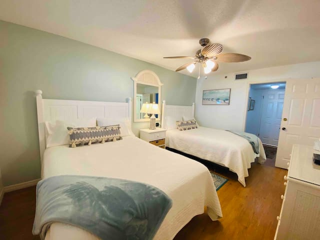Large bedroom #2 with 2 queen size beds, overhead fan and smart TV.