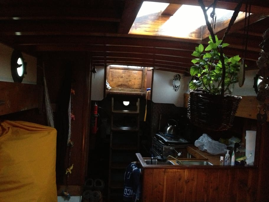 Galley kitchen, propane cooktop, oven in the future