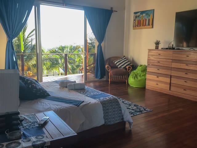 Master Bedroom is on the 2nd floor, with deck, chairs & views of Sunzal Ocean.  Very spacious &  if desired, we can bring up a twin  mattress for a child to share the room.  Xtra large flat screen tv with NetFlix and Cable. A/C. 2 ceiling fans, wifi