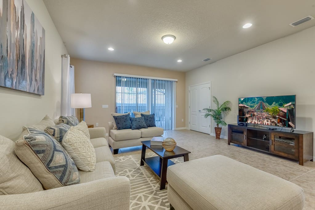 Settle into the comfortable living room furniture to watch a favorite program or movie on the large flat-screen TV with cable and DVD.