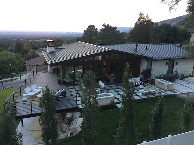 This outdoor living spaces are the best part of my home... outdoor dining and lounge furniture to watch the sun set over Salt Lake City and reflect off Mount Olympus!