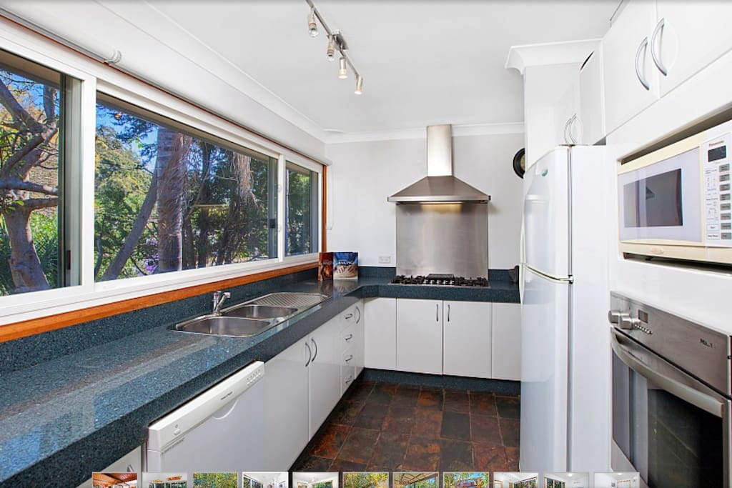 Large kitchen with granite bench tops