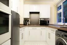 Kitchen - fridge freezer, microwave, washing machine, gas hob, cooking utensils etc, usb charging point