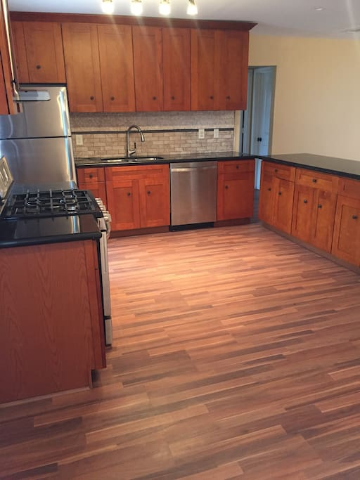 Very spacious and beautiful kitchen. New stainless steel appliances, including refrigerator stove and dishwasher.