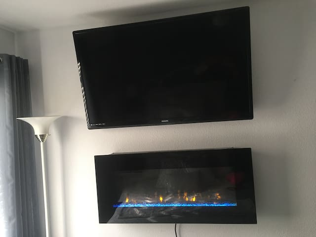 Beach front 50 inch TV and fireplace with heater.