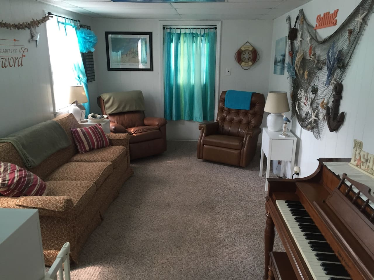 Living room offers, large flat screen tv, DVD player, piano, Queen sofa bed.