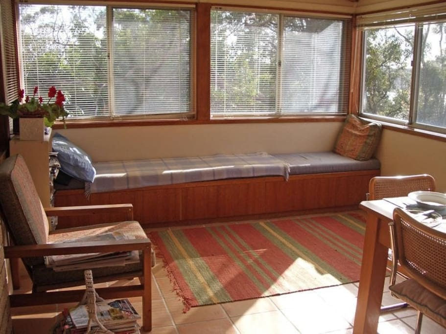 Sunroom with sunny daybed