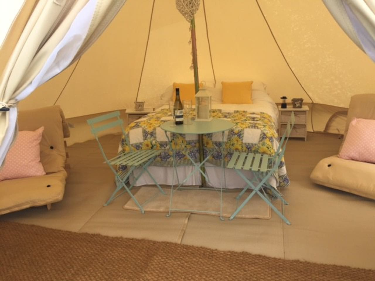 NEW BELL TENT 5MYour luxury Bell Tent  is set in the field adjoining our campsite  with views over scenic countryside, mountains and the Lleyn Peninsula. The 5 metre bell tent sleeps up to 4 and can be set up for a romantic retreat or for a family holiday.  The tent has, duvets and cotton bedding, throw and cushions.