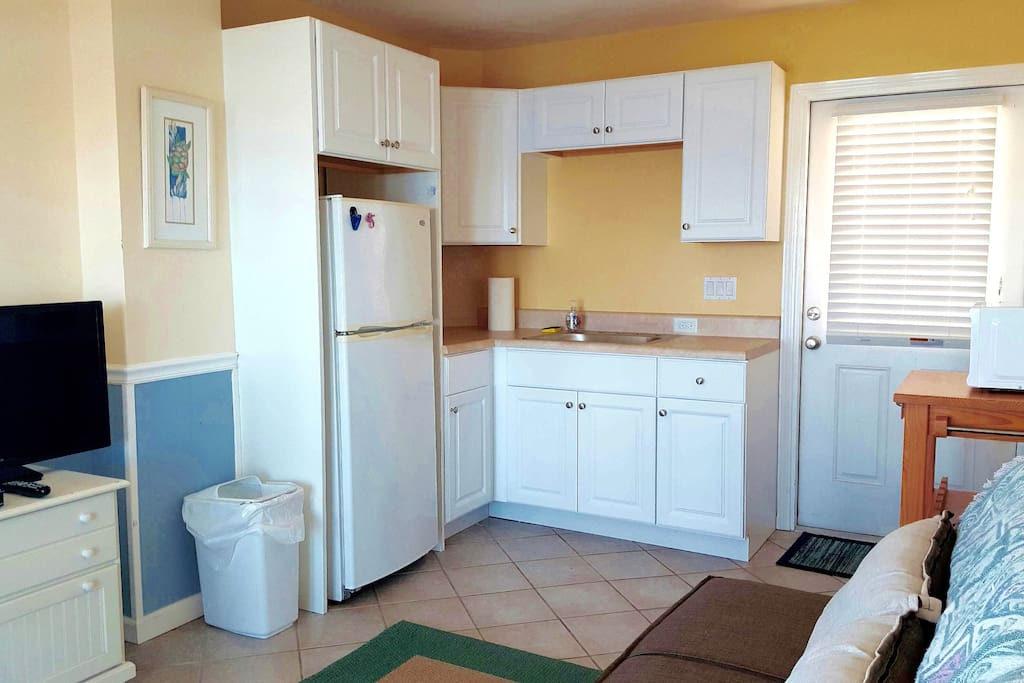 Studio kitchen includes 2 burner cook top, microwave, toaster oven & all housewares.